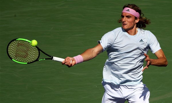 "Locks the ticket to ""8"" Tsitsipas"